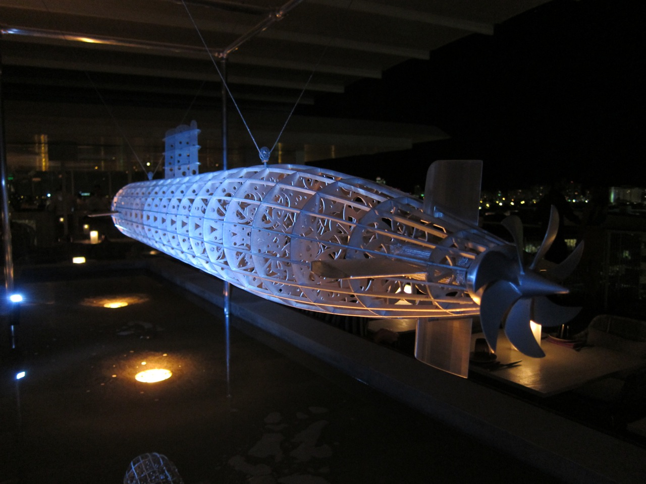 The Smoking Room Submarine, 2012 200 x 23 cm / 80 x 9 inches Aluminum Sculpture (Elevated above a pool)
